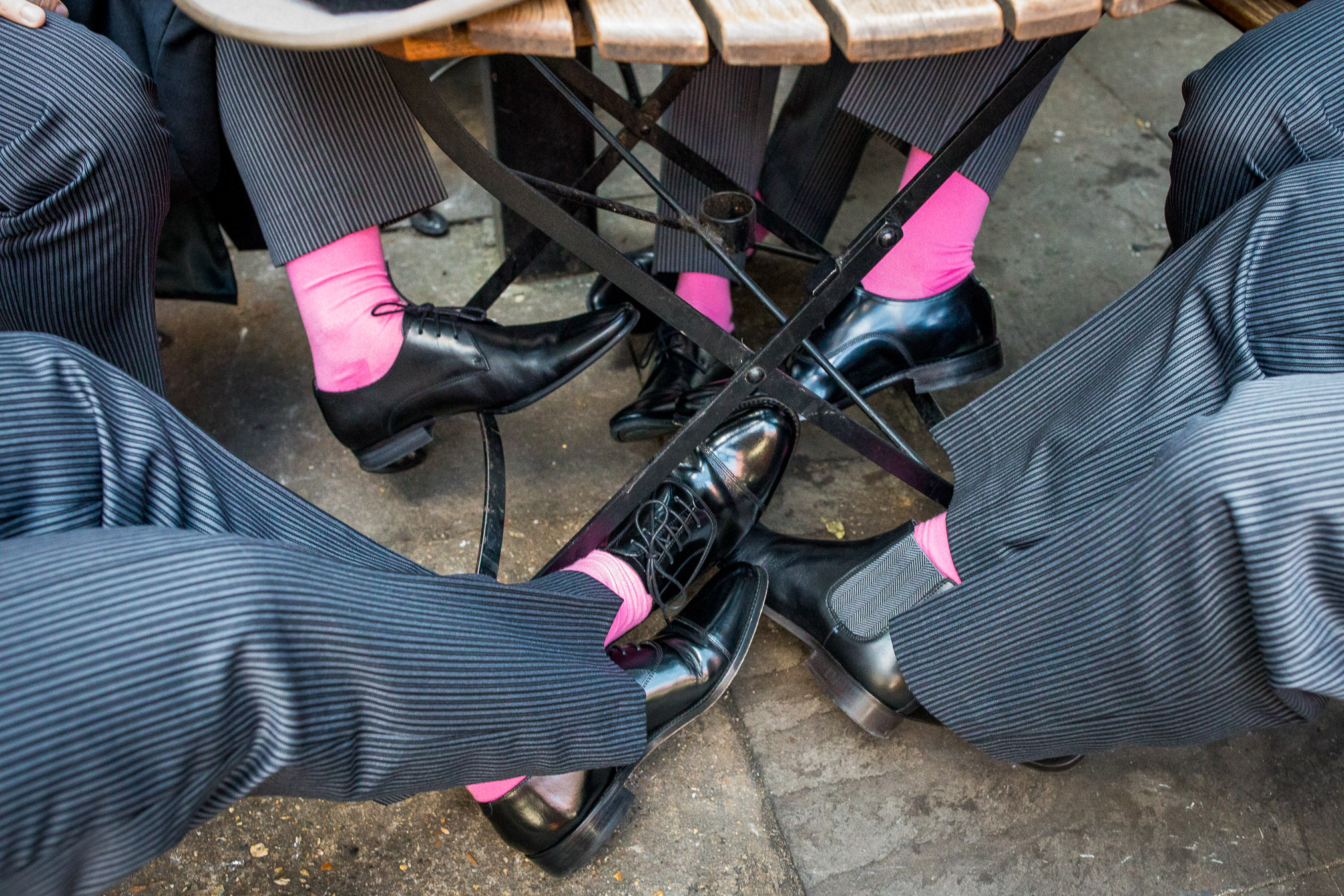 groomsmen with pink socks